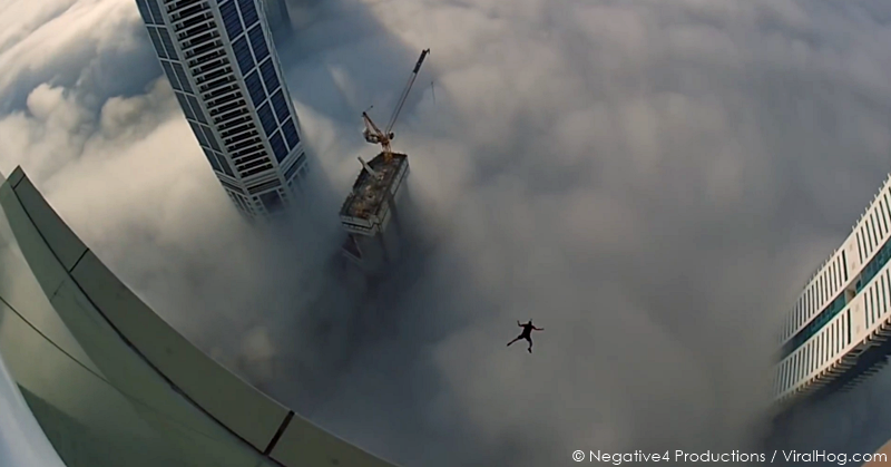 base-jumper-clouds-dubai-uae